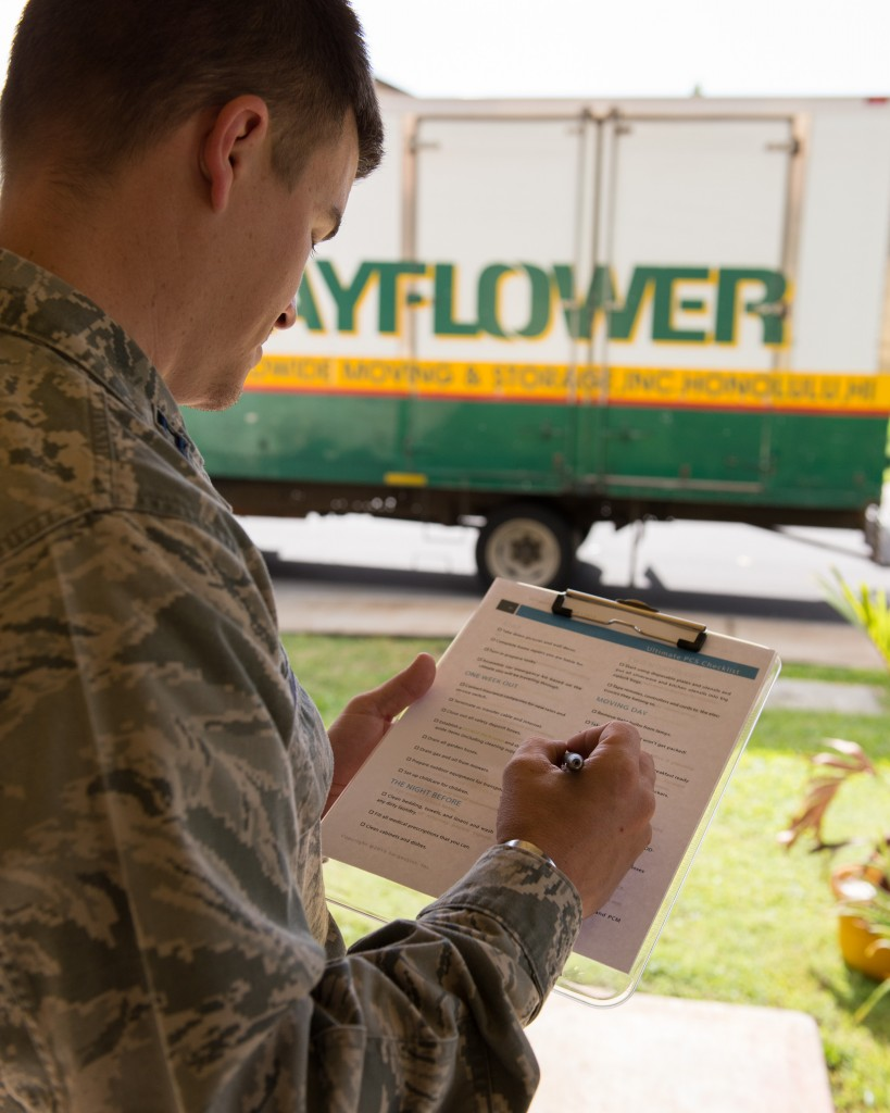 A service member filling out a checklist in the process of moving on PCS orders.