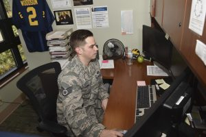 U.S. Staff Sgt. Gabriel Lazurka, financial services supervisor at the 628th Comptroller Squadron, works on his computer Nov. 30, 2016, at Joint Base Charleston, South Carolina. Lazurka was accepted into the Commissioned Officer Training program for healthcare. COT is a five-week program designed to transition Airmen and civilians into the U.S. Air Force commissioned officers corps. (Photo by Airman 1st Class Kevin West)