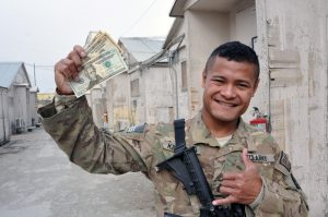 """Sgt. McMillan """"Kit"""" Kitalong, a fire team leader for Echo Company, 1st Battalion, 294th Infantry Regiment, Guam Army National Guard, collected donations from unit members recently to aid the island of Palau, which was hit by Typhoon Haiyan early November. Kitalong received about $600 from his squad and company. He sent the money to the Red Cross. (U.S. Army National Guard photo by Sgt. Eddie Siguenza/Released)"""