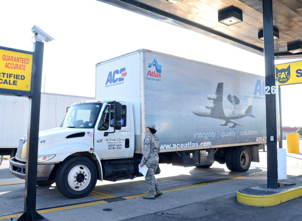 Senior Airman Brandie Benoit, with the 72nd Logistics Readiness Squadron, watches as a moving truck rented by a military family is re-weighed at a local weigh station. (Air Force photo by Kelly White)