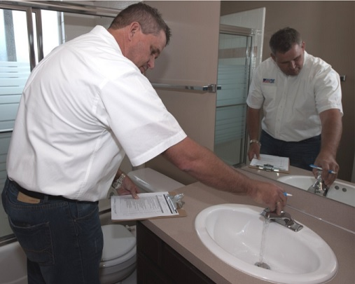 A property manager conducts an inspection.