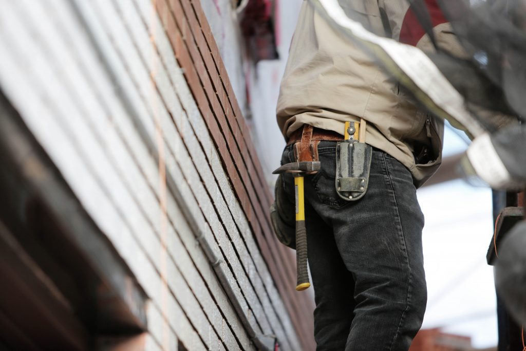 Contractor, handyman, or property manager making house repairs
