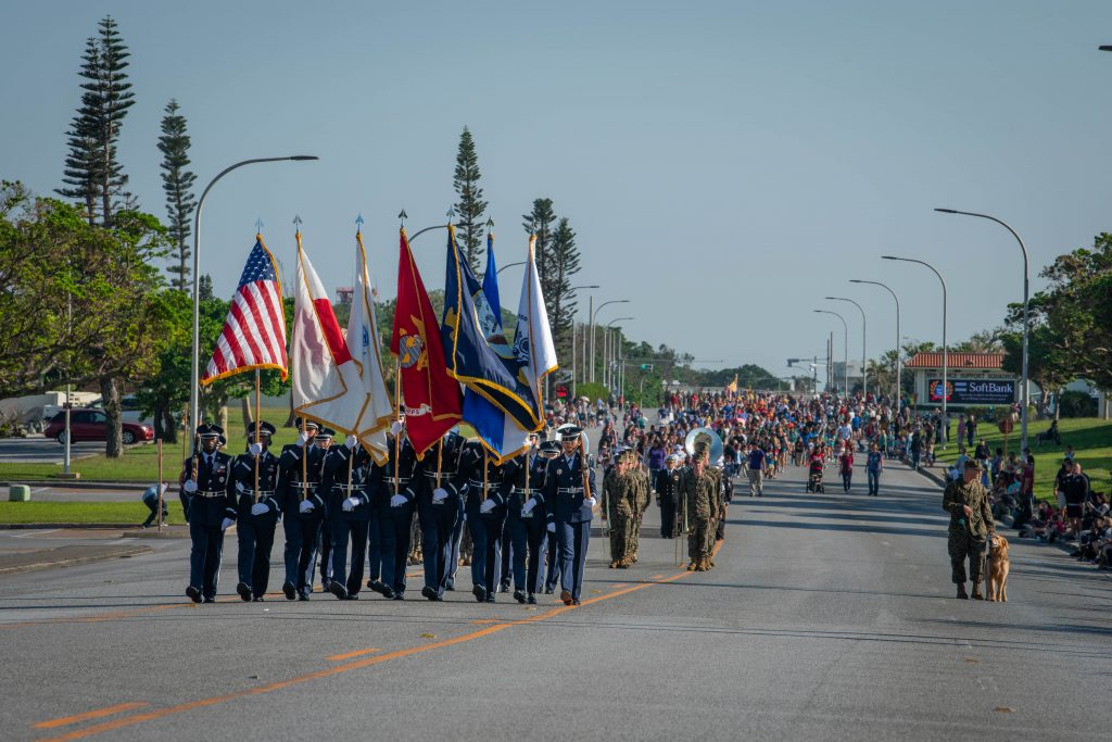 U.S. military members, veterans and their families participate in the Veteran's Day Parade, Nov. 11, 2018, at Kadena Air Base, Japan. Veteran's Day Parades are celebrated across U.S. military stations both at home and abroad. (U.S. Air Force photo by Senior Airman Kristan Campbell)