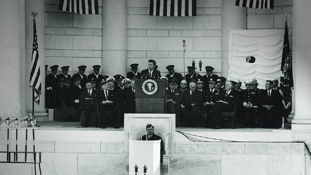 President John F. Kennedy speaking at Arlington National Cemetery on Veterans Day, 1961.