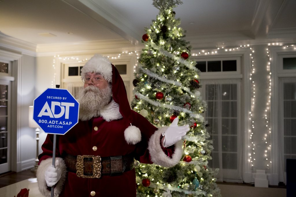 Santa Claus, with the help of ADT, protecting your home for the holidays.