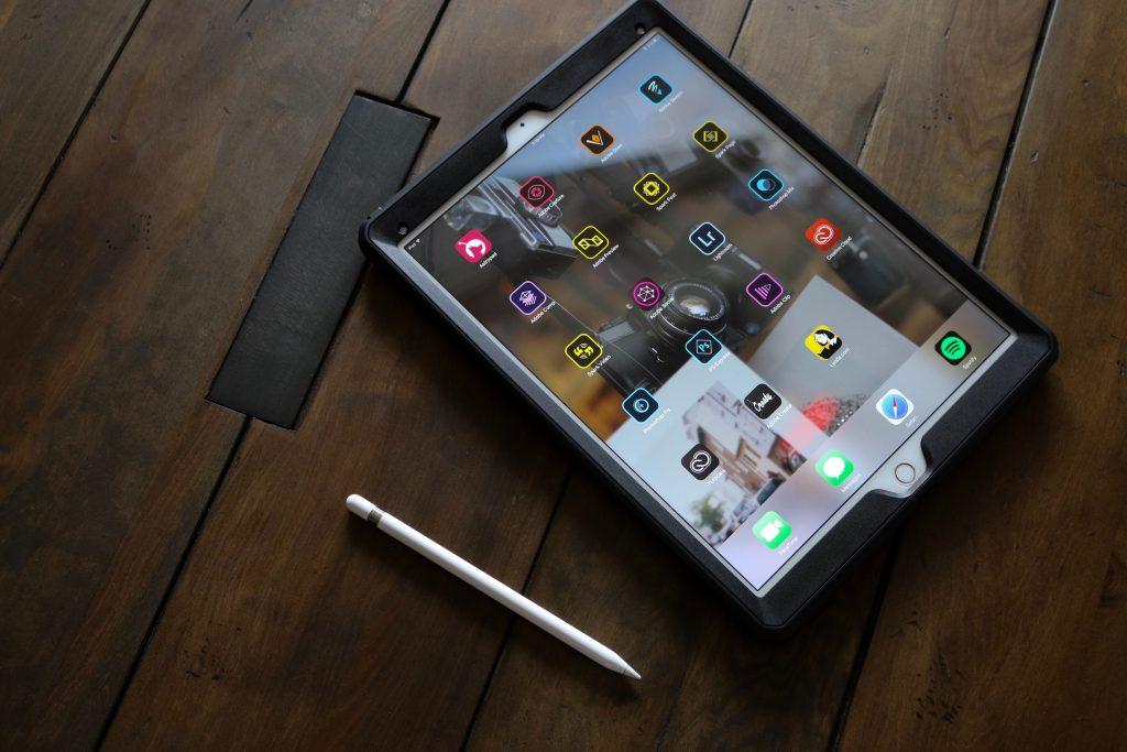 Tablet displaying apps. Photo by Garrhet Sampson on Unsplash.