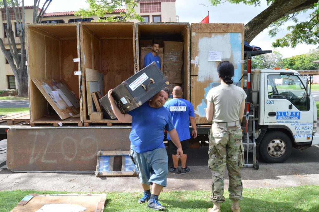 WHEELER ARMY AIRFIELD —1st Lt. Kathryn Bailey, a Black Hawk pilot with the 2nd Battalion, 25th Aviation Regiment, 25th Combat Aviation Brigade, 25th Infantry Division supervises the delivery and unpacking of her household items during her PCS moved on May 11 on Wheeler Army Airfield. (Photo by Karen A. Iwamoto, Oahu Publications)