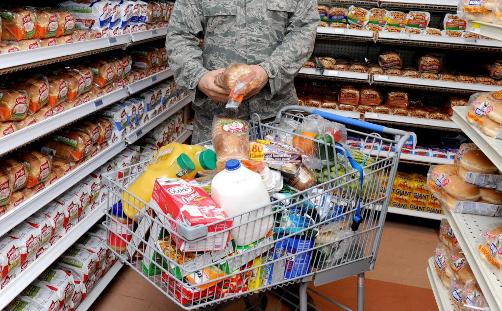 Second Lt. Ben Garland, 375th Air Mobility Wing public affairs chief of media operations, tops off his shopping cart stuffed with groceries with two loaves of bread at the Commissary, March 9, 2012, at Scott Air Force Base, Ill. Photo by Staff Sgt. Brian Valencia 375th Air Mobility Wing Public Affairs